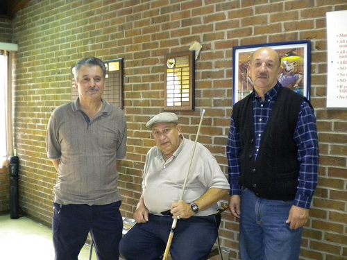 Three Senior Men Part of Pool League