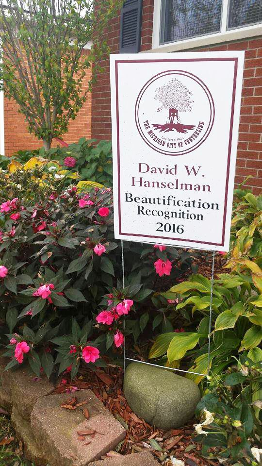 David W. Hanselman Beautification Recognition 2016 Sign with Pink Flowers Behind