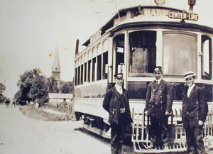 Vintage Photo of Three Men Stand in Front of Center Line Street Car